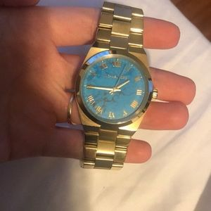Gold Michael Kors watch with blue marble face